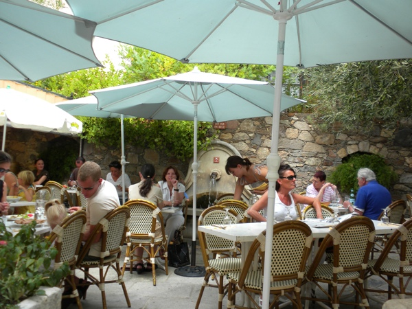 People having lunch under the parasols
